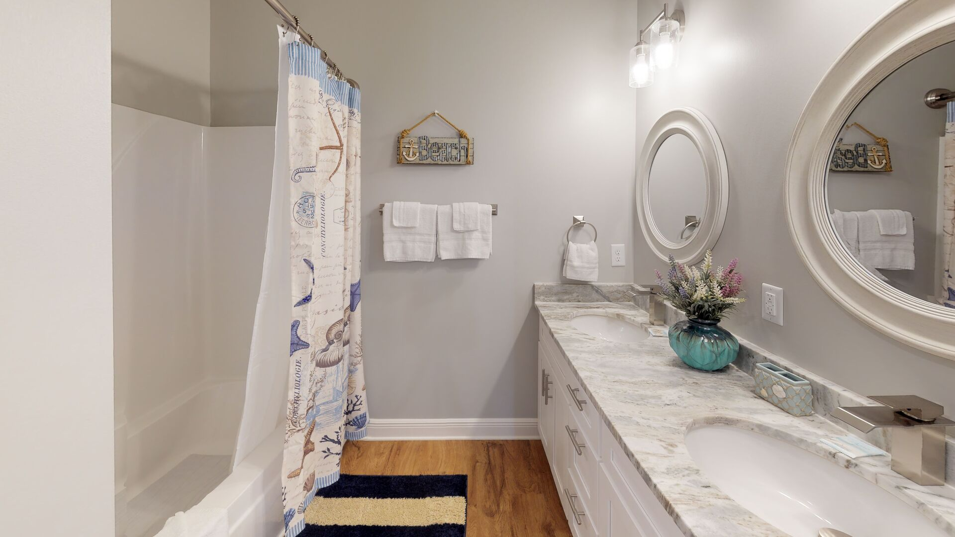 Double Sink Vanity, Mirrors, and Shower-Tub Combo.