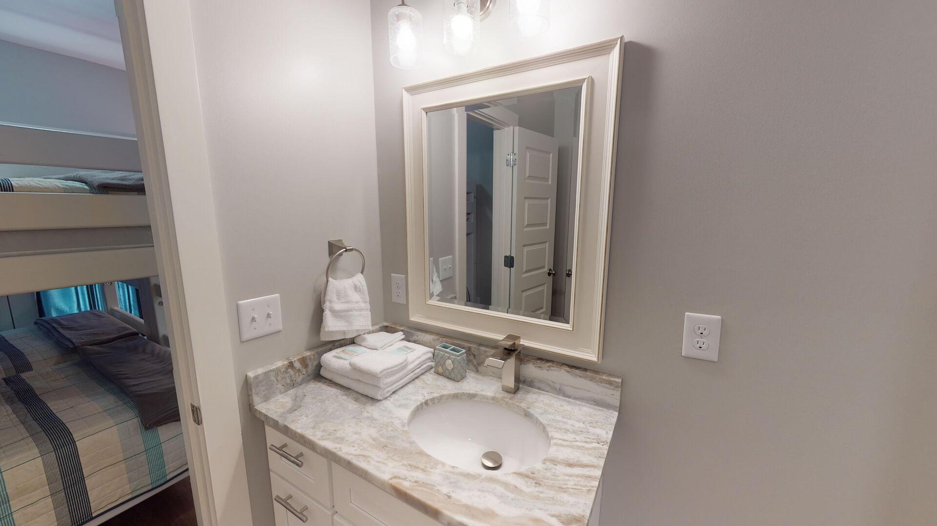 Single Vanity Sink, and Mirror.