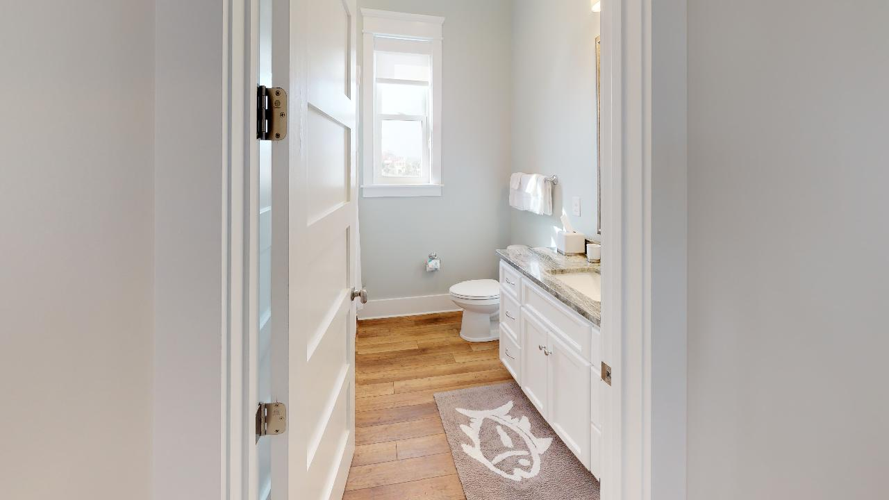 Common area shared bathroom with tub/shower combo