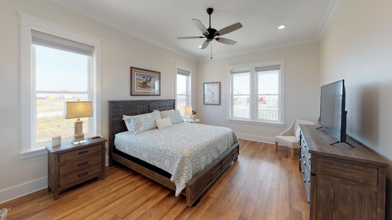 Master bedroom has king bed, TV, gulf views