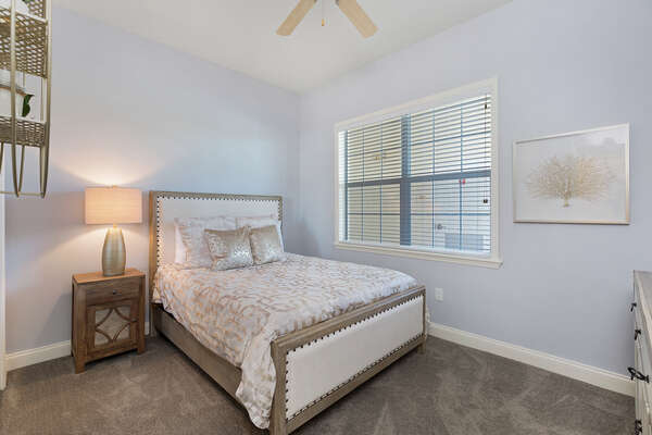 The second bedroom has a queen-sized bed with a SMART TV