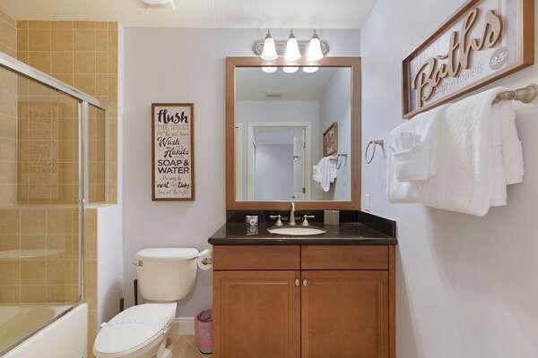 Full bathroom with a bath tub/shower combo