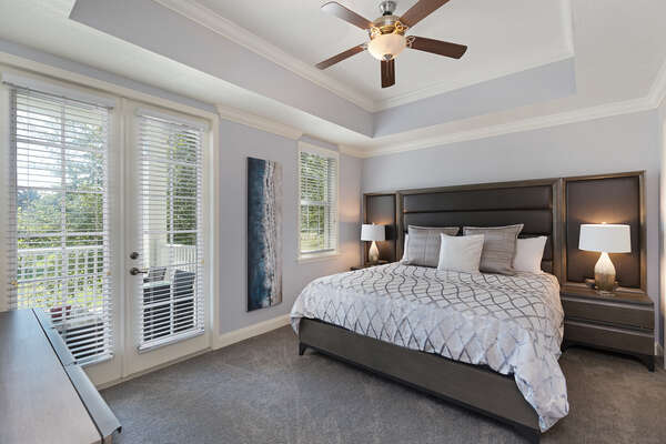 The master suite has an en-suite bathroom and access to the balcony