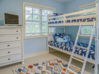 Twin bunk beds in guest bedroom on main level