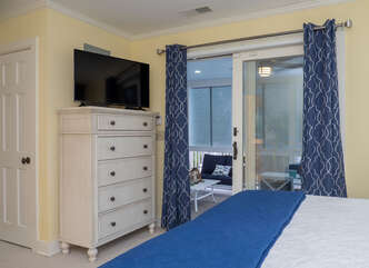 Master bedroom has access to screened porch