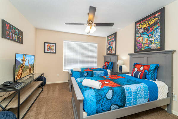 Bedroom 5 has twin beds, flatscreen TV, Playstation console and Spiderman theme