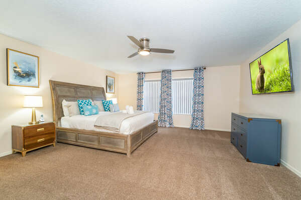 Master bedroom (upstairs) with king bed and wall mounted flatscreen