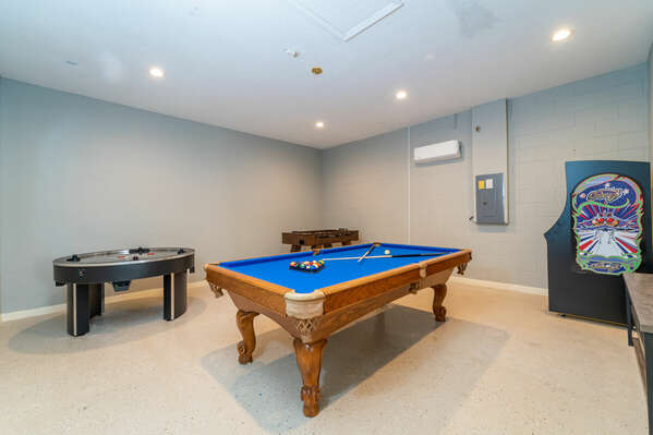 Games room showing pool table and circular air hockey game