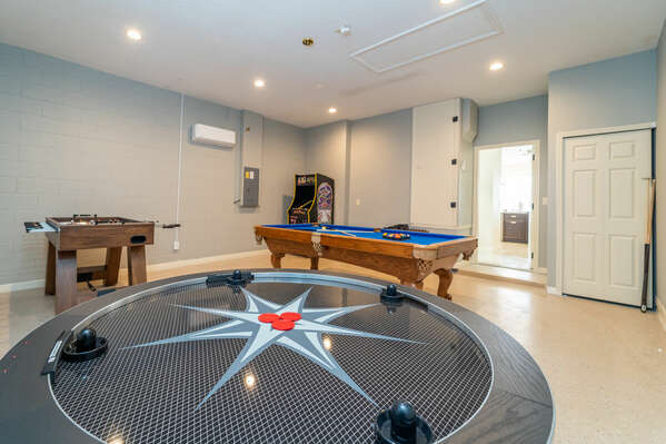 Photo of four player air hockey game in games room