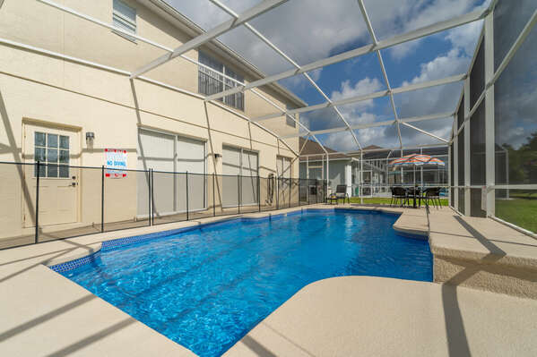 View of pool area with baby safety fence in place