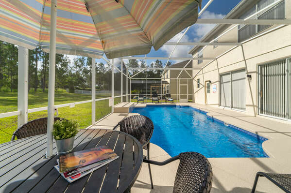 Side shot of the pool and patio furniture