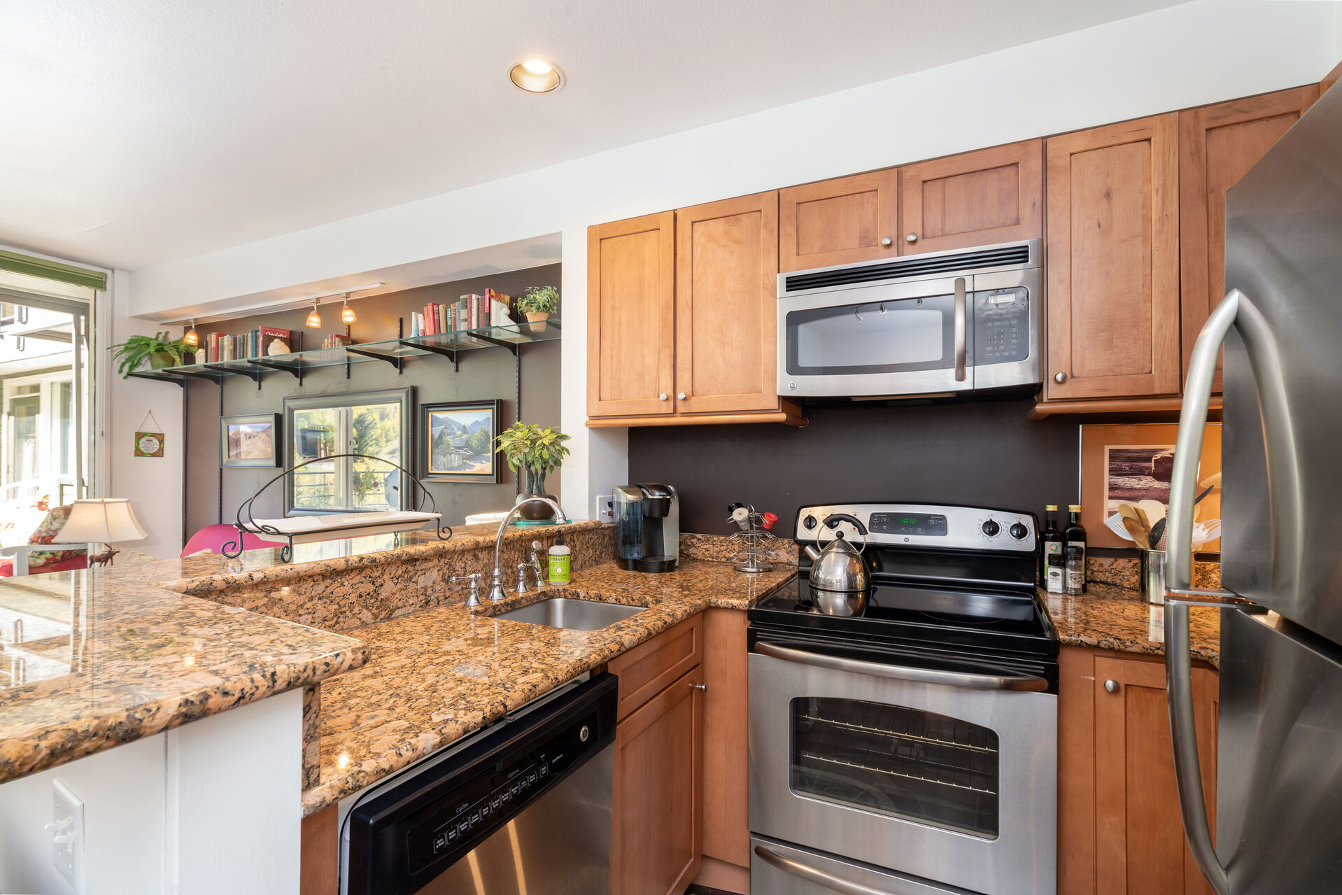 The kitchen of this Telluride condo, with stainless steel appliances and bar seating.