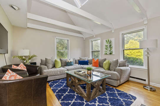 Living area with confy couch and leather chairs for ample seating 50 Blue Heron Eastham Cape Cod - New England Vacation Rentals