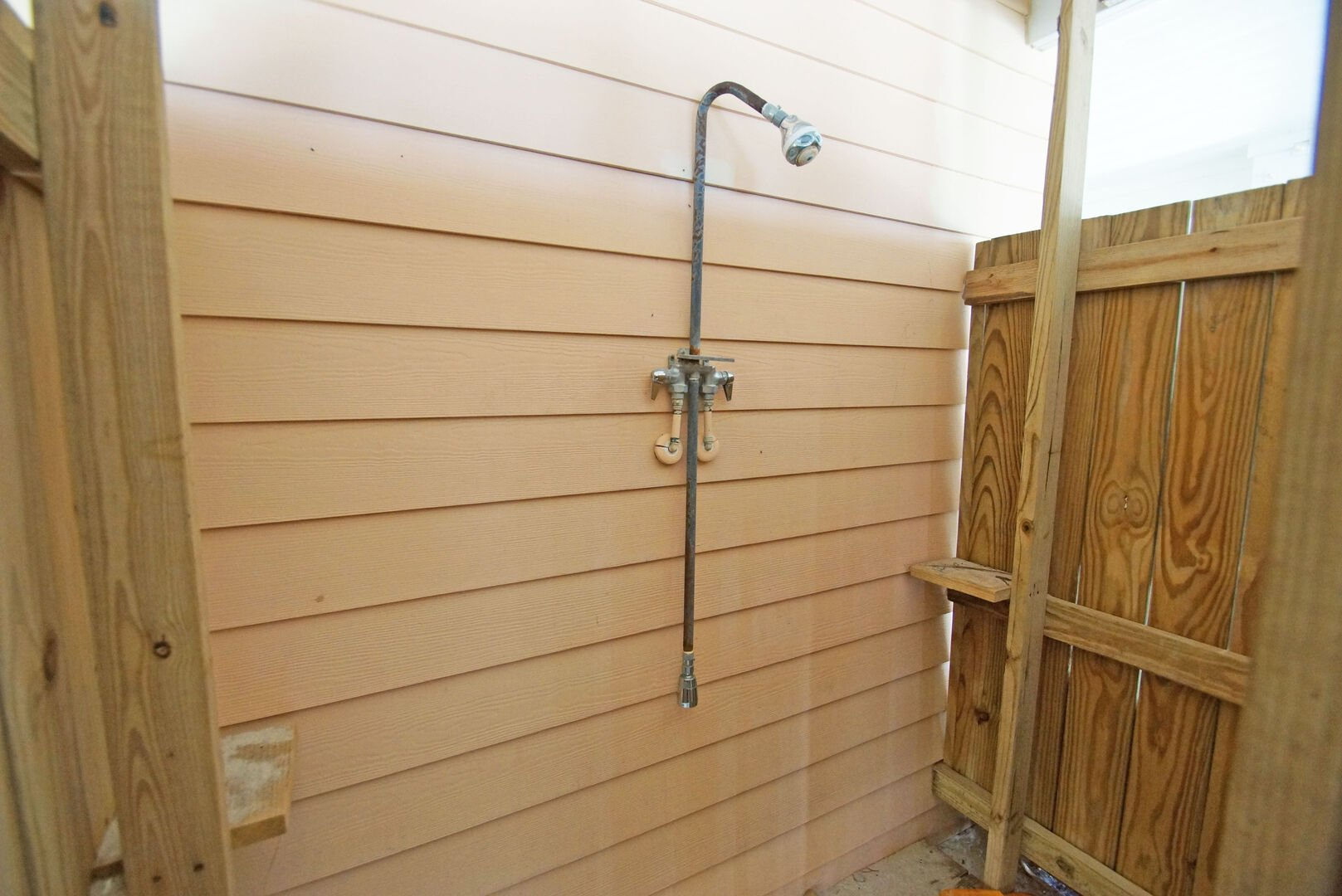 Guests Can Rinse Off in an Enclosed Outdoor Shower.