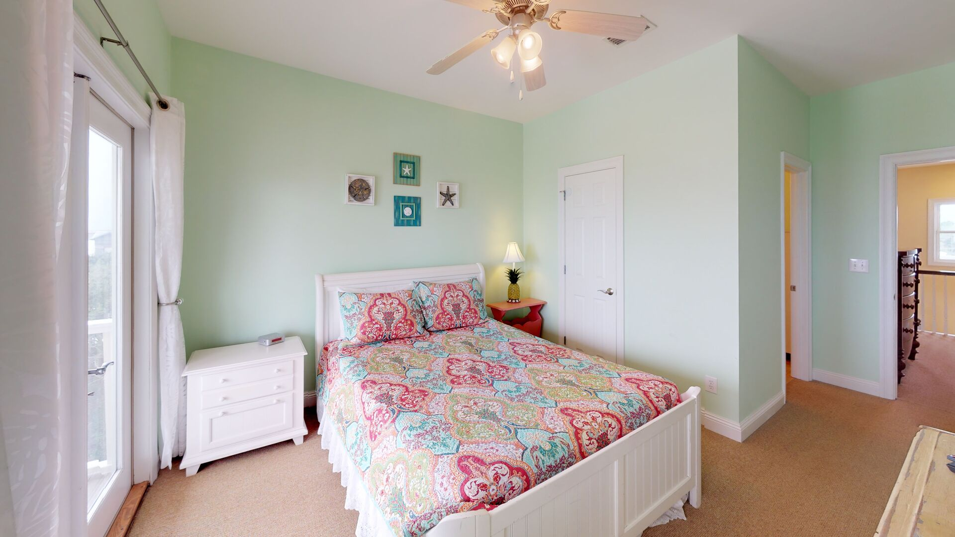 Spacious Bedroom Offers an Attached Bathroom and Deck Access.