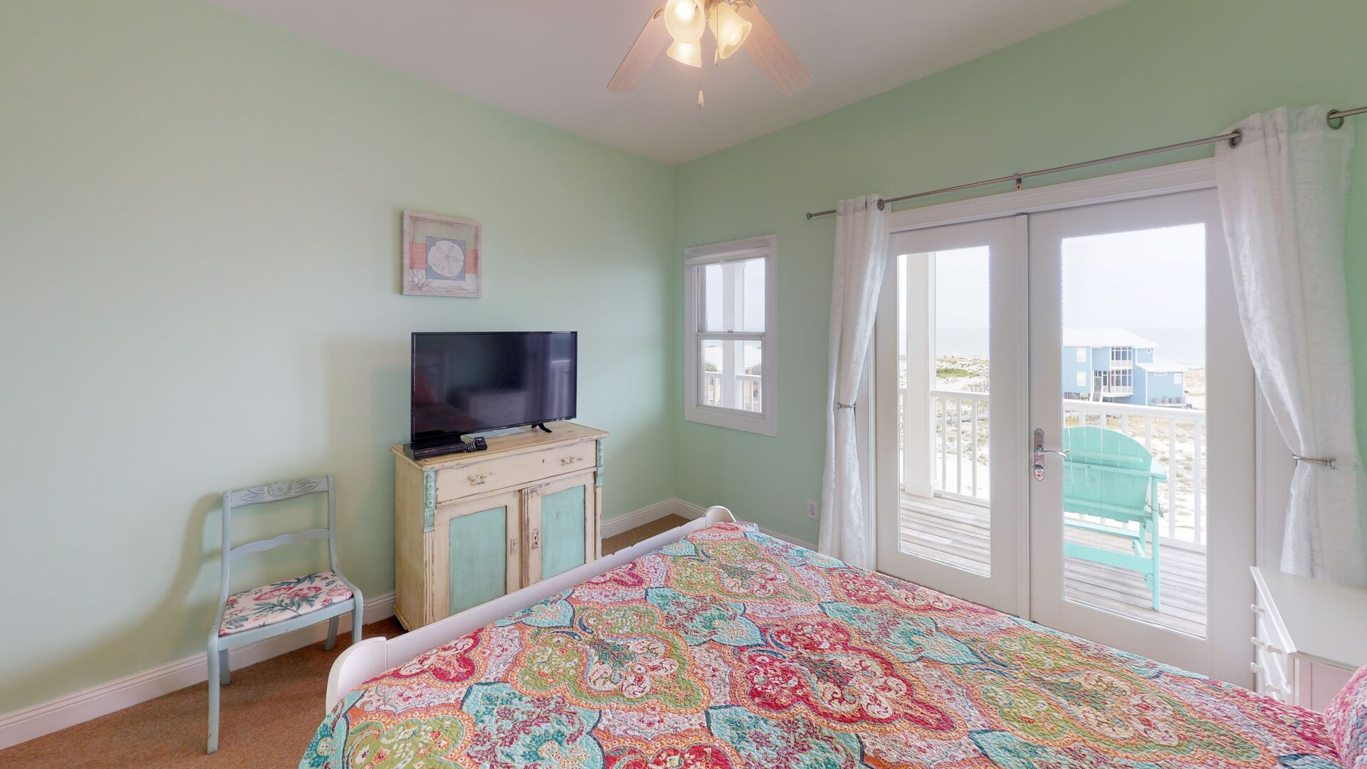 Bedroom Features TV and Outdoor Deck Access.
