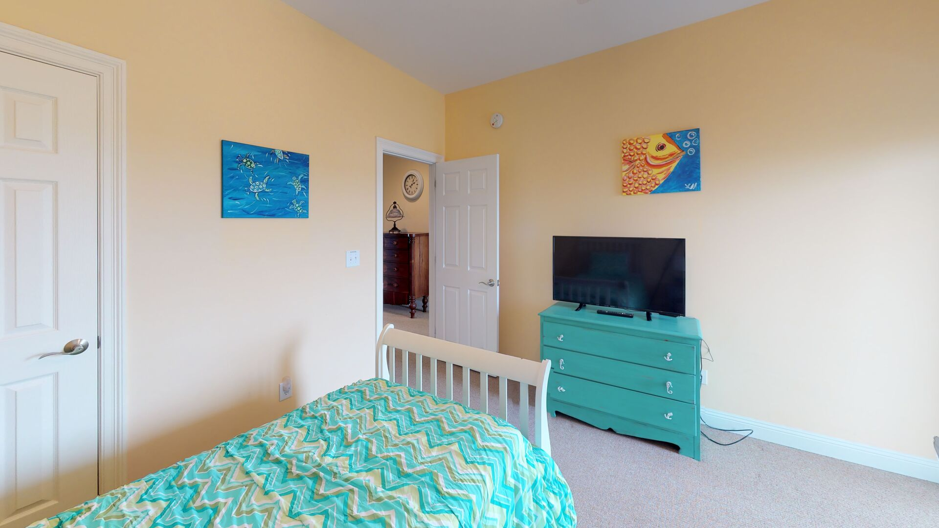 Bedroom Features a TV and Deck Access.