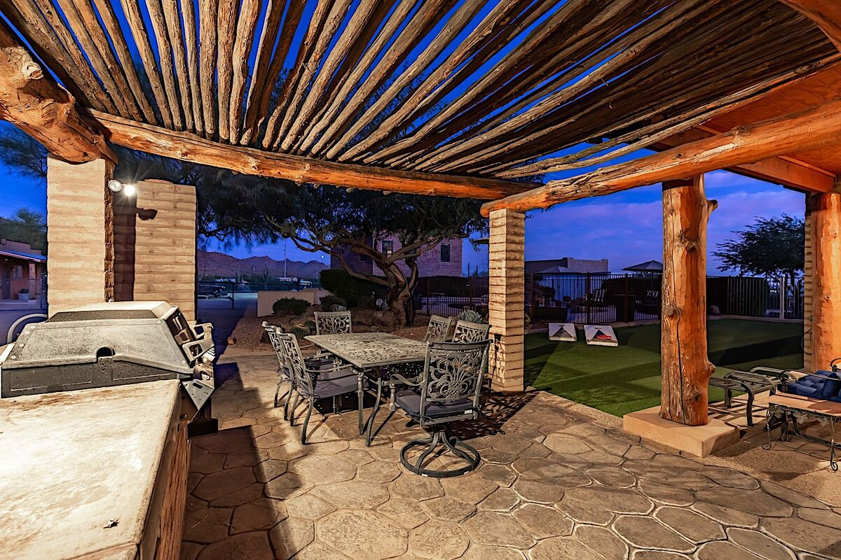 Outdoor dining area with built in BBQ and fireplace