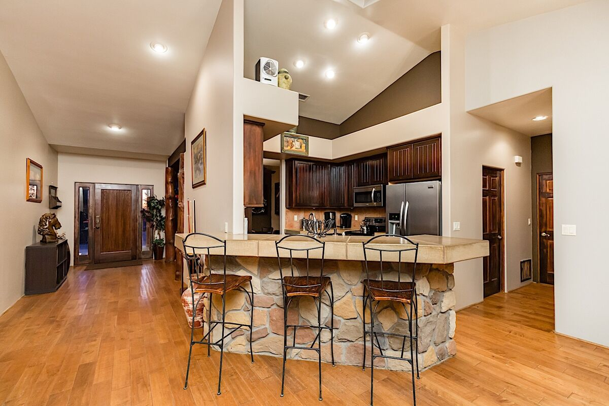Front foyer, breakfast bar, and kitchen