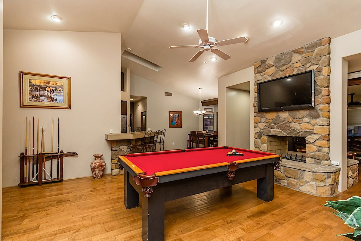 Pool table in great room area with flat screen TV