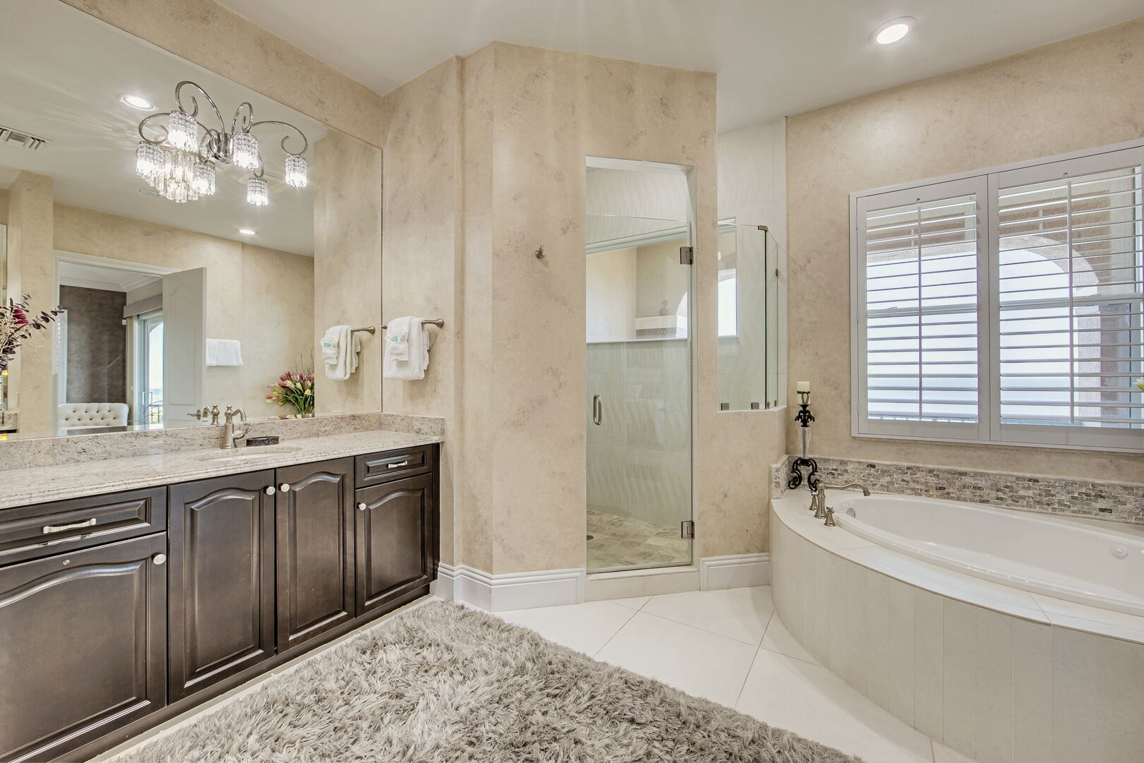 Bathroom with Shower, Bathtub, Single Vanity Sink, and Mirror.
