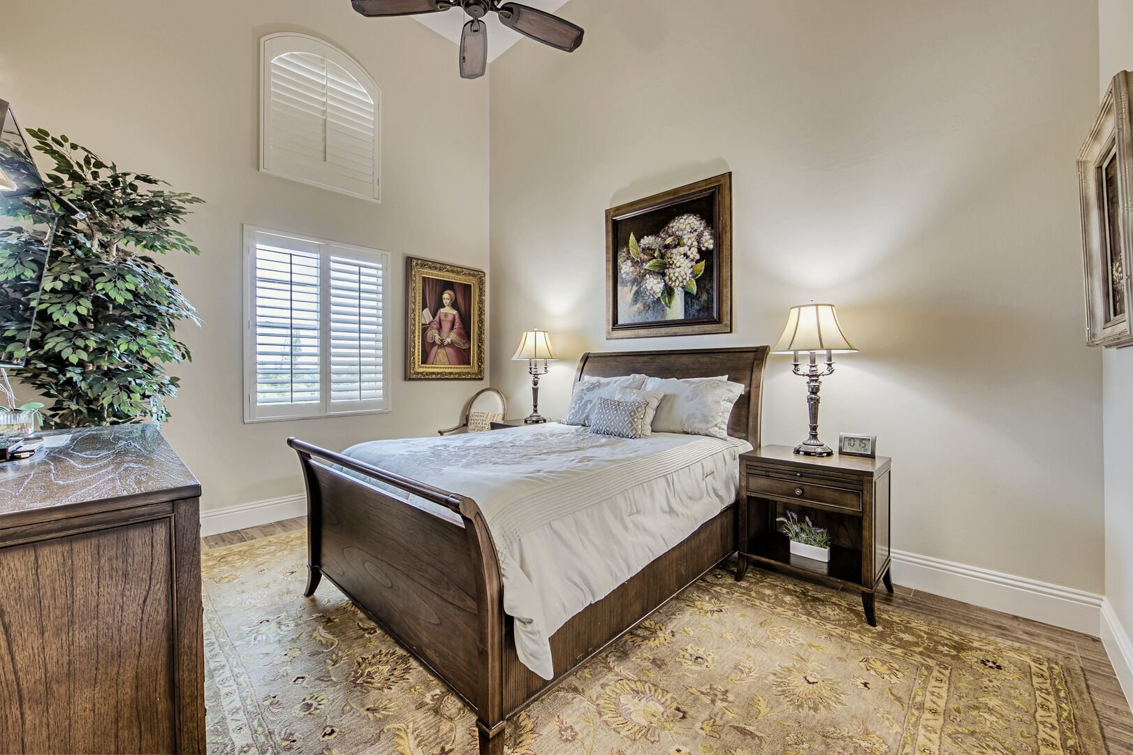Large Bed, Dresser, Ceiling Fan, Nightstands, and Table Lamps.