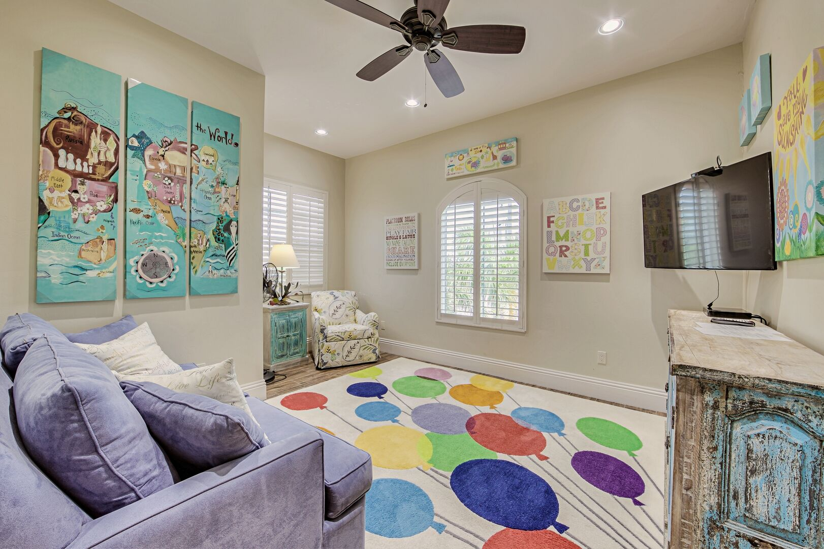 Children's Room with Sofas, TV, Dresser, and Ceiling Fan.