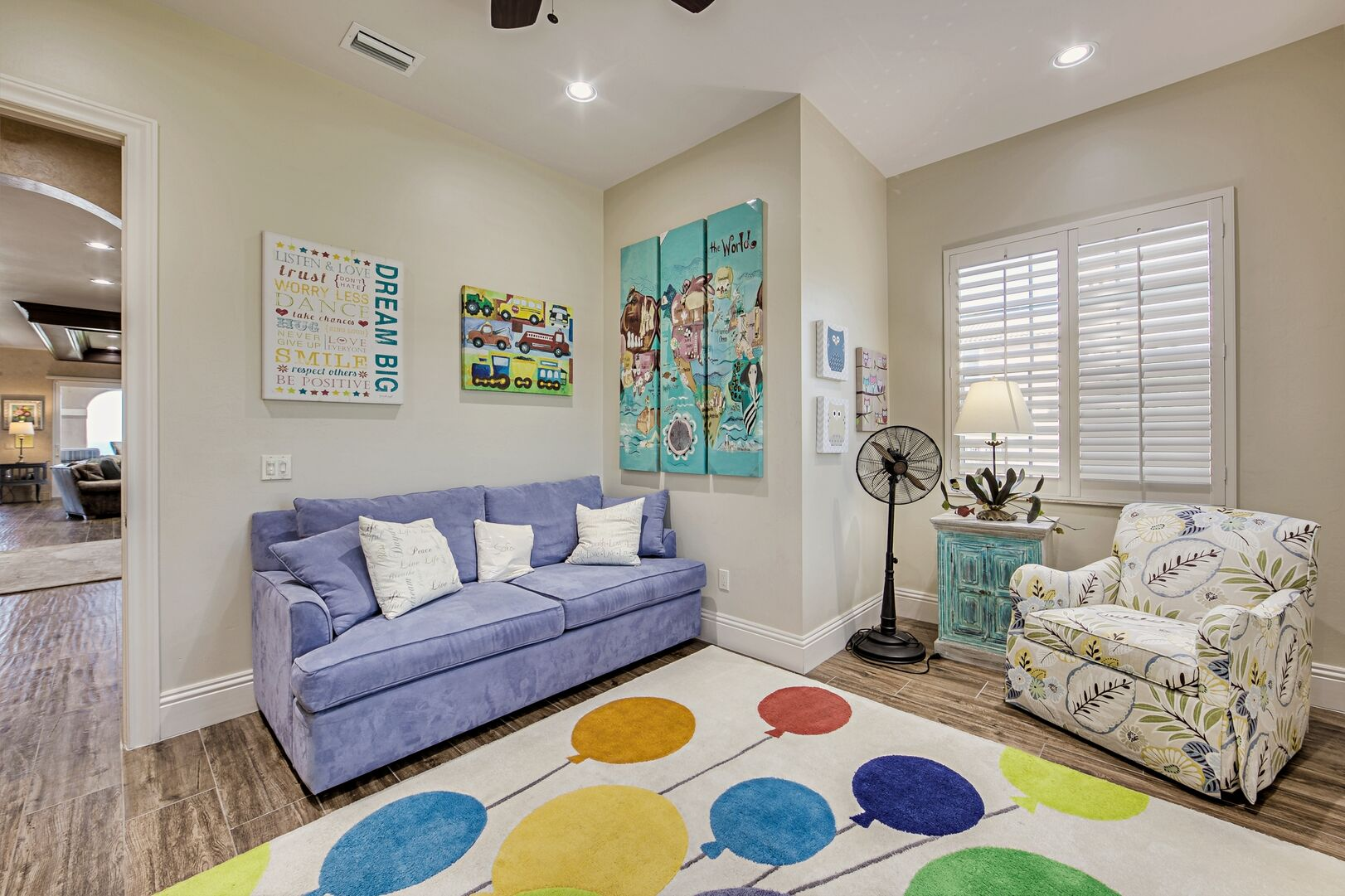 Children's Room with Sofas, Nightstand, and Table Lamp.