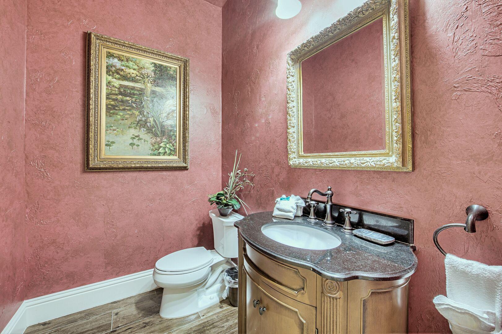 Bathroom with Single Vanity Sink, Mirror, and Toilet.