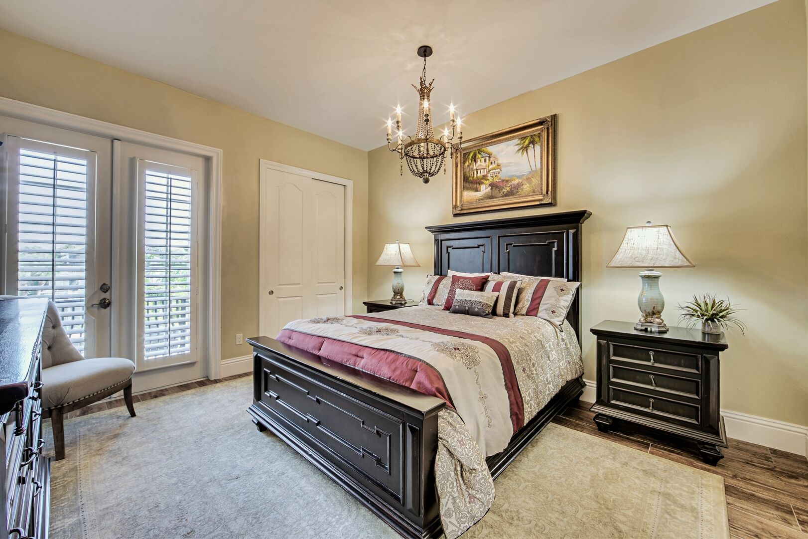 Large Bed, Dresser, Closet, Nightstands, and the Window Doors to the Balcony.