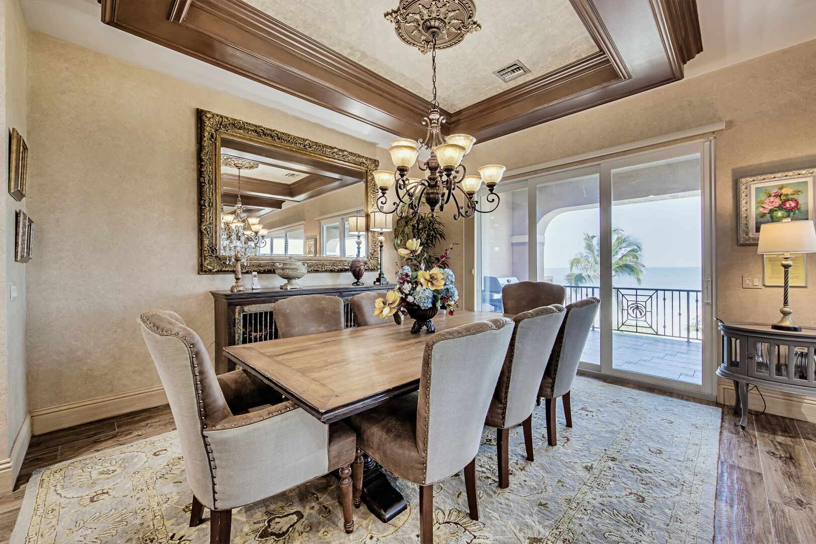 Dining Set, Chandelier, Console Table, Mirror and Sliding Doors to the Balcony.
