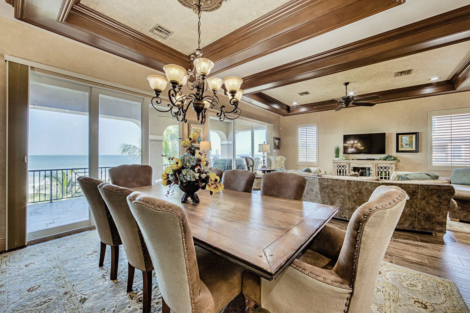 Dining Set, Sofas, TV, Ceiling Fan, and Sliding Doors to the Balcony with Gulf View.