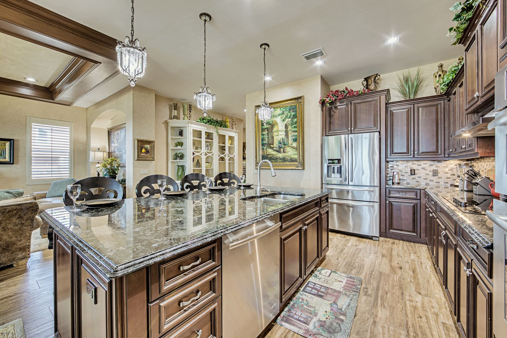 Kitchen with Island, High Chairs, Refrigerator, and Dishwasher.