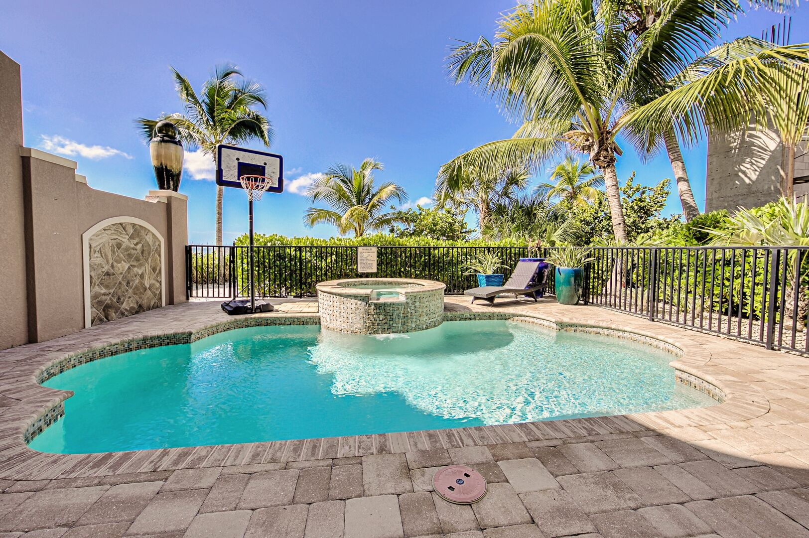 Fenced Private Pool and Jacuzzi with Lounge Chair and Basketball Hoop.