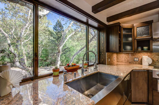 Granite Counters, Stainless Farm Sink, and an Expansive Window for Natural Light and Views