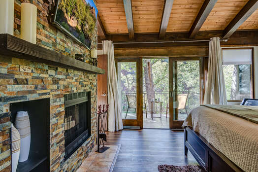 Master Bedroom with a Smart TV and Private Patio Overlooking Oak Creek