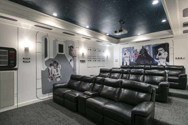 12 leather theater-style seats