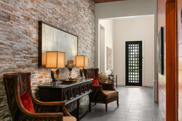 The foyer includes a sitting area with exquisite details