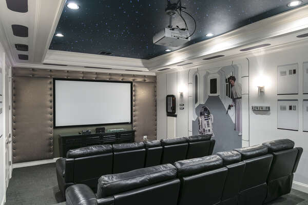 Have a movie night with family in the private home theater
