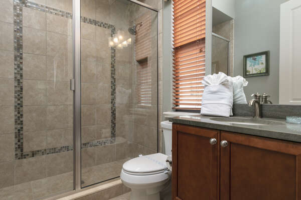 Get ready in the private ensuite bathroom
