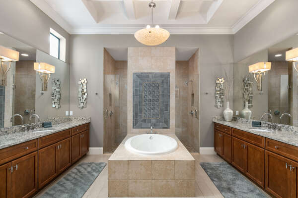 Unwind in the beautiful garden tub or get ready at the extensive vanity in the ensuite bathroom