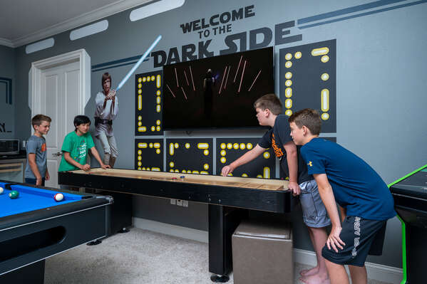 This galactic second floor game room has tons of games that any one can enjoy from a shuffle board