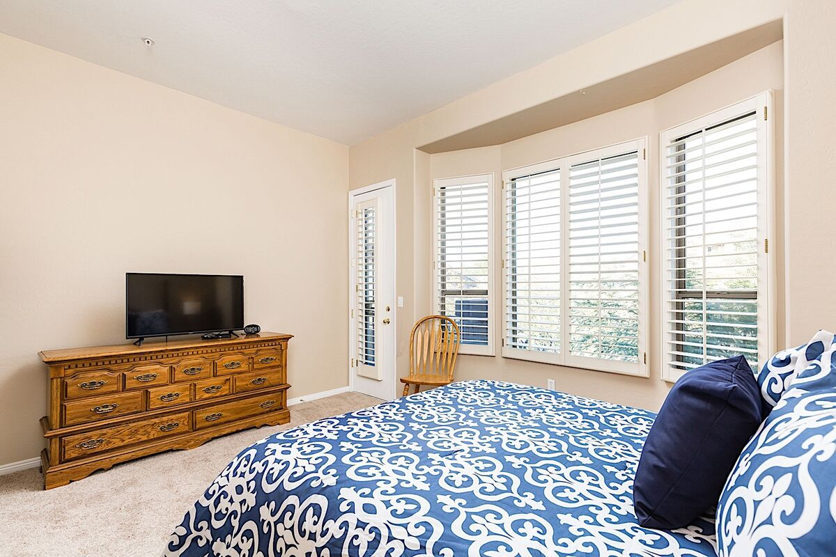 Master bedroom- Flat screen TV with cable and access to upper level patio