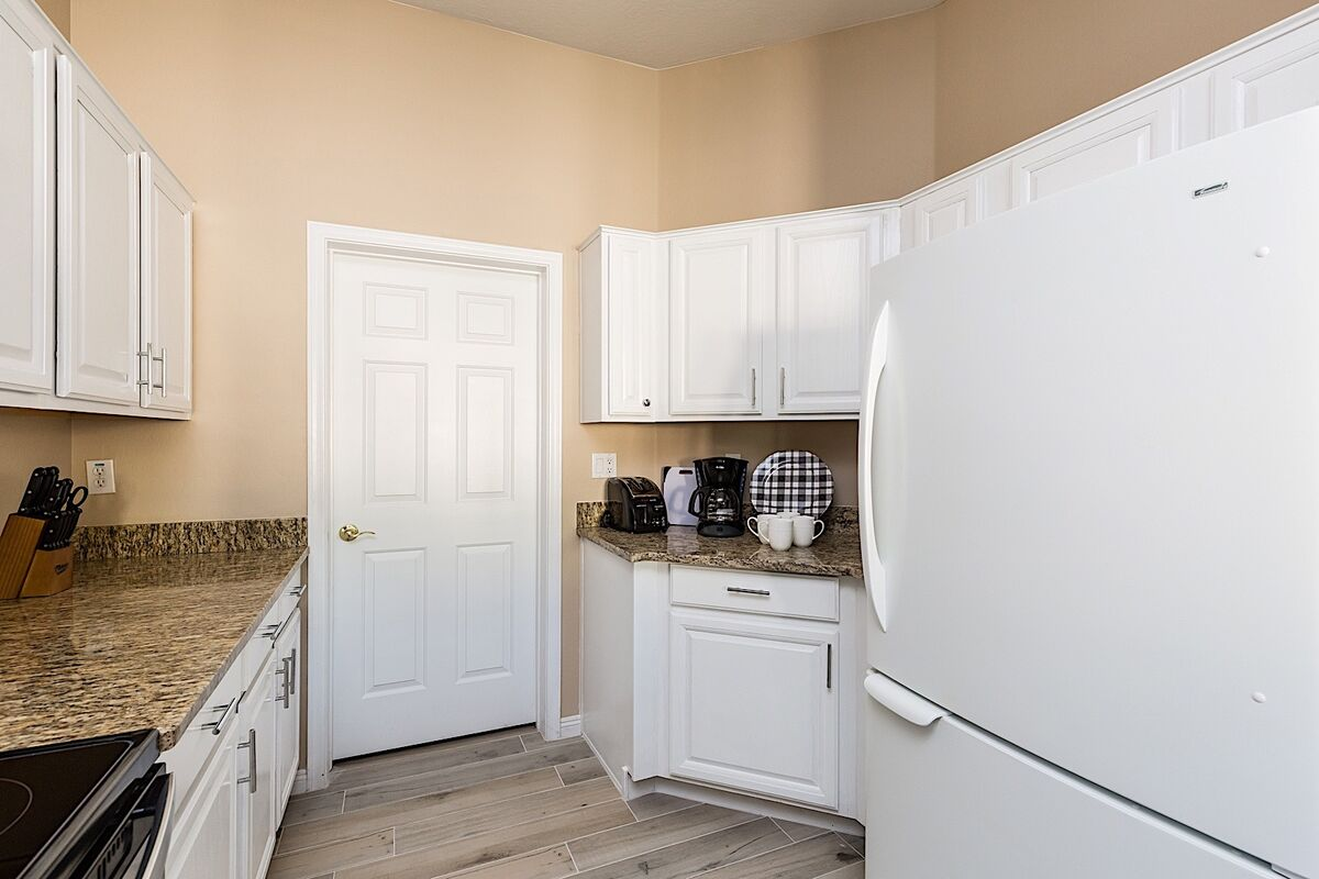 Kitchen leads to laundry room.  Look at the little coffee nook!
