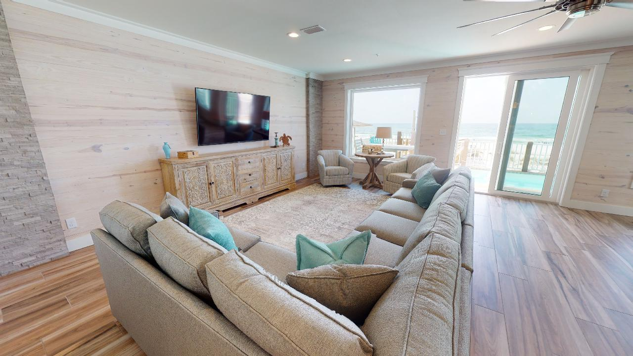 Living Area with large sectional and TV