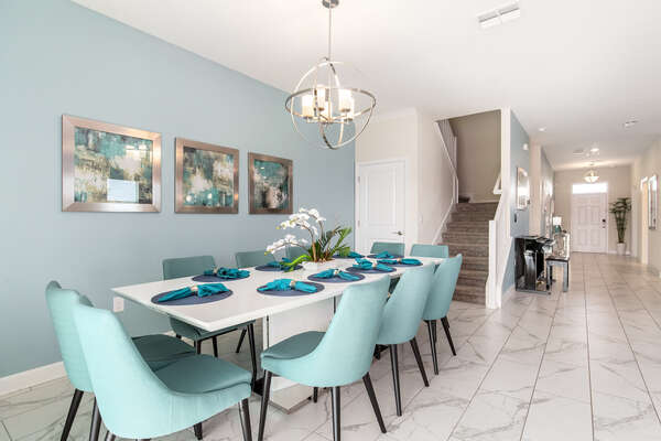 The formal dining table seats up to 10 guests, extra seating for 4 at the breakfast bar