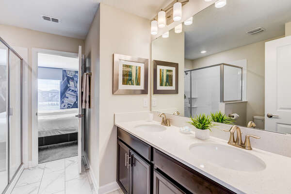 Both bedrooms share a Jack and Jill bathroom with a dual vanity and walk-in shower
