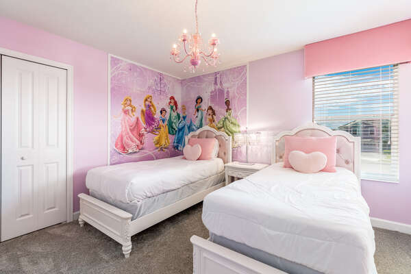 Your little princesses will feel right at home in this regal bedroom
