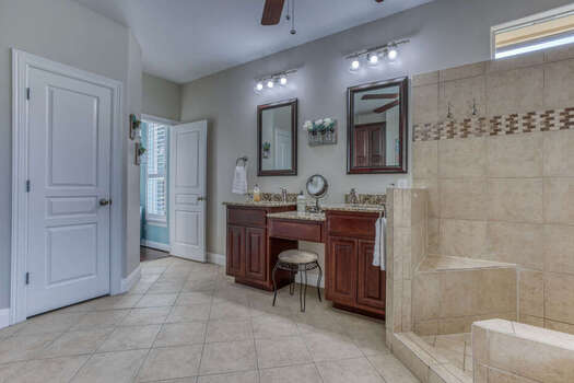 Dual Sinks, a Makeup Vanity, and Large Tile Shower