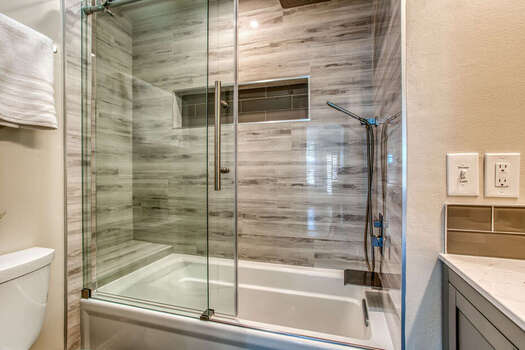 Main Level Full Shared Bath with a Tub Shower
